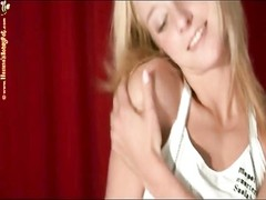 Skinny blonde stars in sensual striptease video Thumb