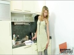 Pretty dress and blue pantyhose on a blonde teen Thumb