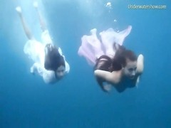 three chicks receive bare swimming in the ocean Thumb