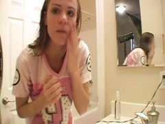 adorable  teenage  does her makeup and talks soiled Thumb