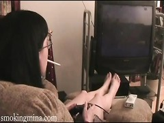 Mina plays a videogame and smokes Thumb