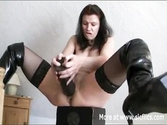 Frustrated amateur tart  wanks and penetrates herself with a huge gloomy dildo Thumb