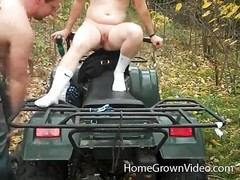 lovers pounds on the ATV in the woods Thumb