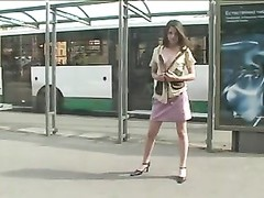 bad in public Brunette flashing at the crowde bus stop Thumb