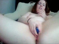 bad talking redhead with her vibrator Thumb
