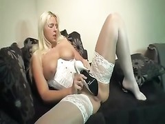 lady in satin corset puts shoe in her twat Thumb