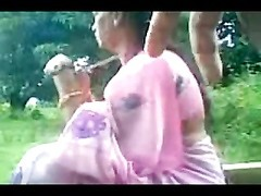 Daring Desi Aunty Sucks Uncles Cock Outside in the Park Thumb