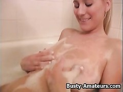 Busty blonde Autumn playing her pussy in bath tub Thumb
