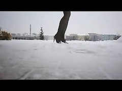 Nylon legs and tall heels in snow Thumb