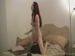 Classy redhead babe tries out the new machine Thumb