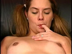 Pigtailed pornstar is fingering her wide-opened snatch Thumb