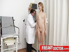 Sporty redhead Electra Angel checked by aged cunt doctor Thumb