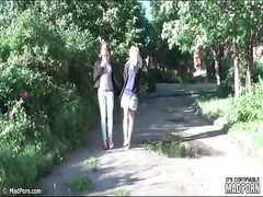 Lesbian girlfriends on a walk enjoy kissing Thumb