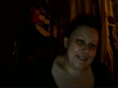 Old Russian BBW lady is posing on the webcam and showing her giant melons Thumb
