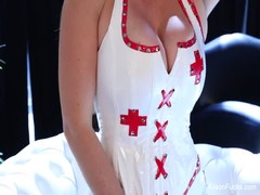 Busty nurse Alison toys her wet pussy Thumb