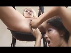 Asian babe fucks her blonde girlfriend with strapon Thumb