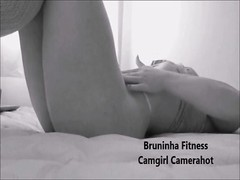 Fitness girl with webcam on the bed Thumb