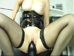 Wife in latex and boots takes huge toy in pussy Thumb