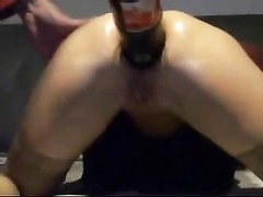 Stretching the ass of his wife with bottles Thumb