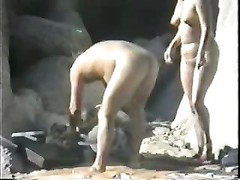 Wife blows her hubby at the beach Thumb