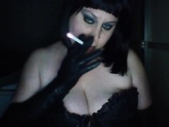 Milf with big tits smoking and talking in gloves and corset Thumb